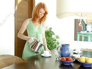 Attractive redhead teen Mia Sollis posing