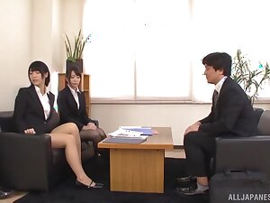 Sexy Asian chicks get talked into playing with cocks in the office